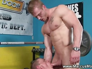 Gay jocks get hot and sweaty during their workout at the gym