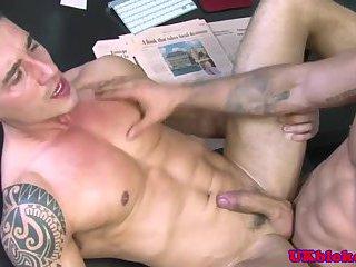 Muscular english lads kissing