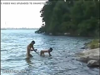Steamy gay sex on the lake shore